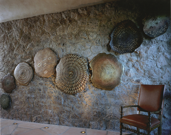 Eight piece wall sculpture incorporating various fossils. 14' x 11'