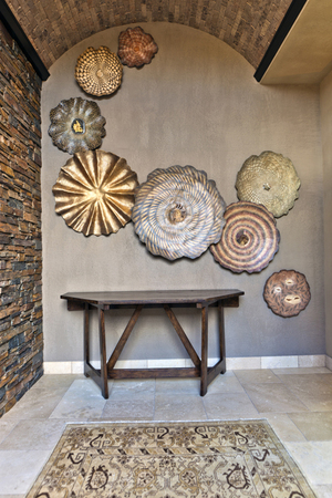 Interior view of 8 fossil wall sculptures in residential entryway : Installations and Commissions : Fossil and organic mixed media sculpture by Lee Brotherton